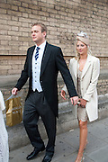 HOLLY BRANSON; FREDDIE ANDREWS LEAVING THE RECEPTION WITH GOODY BAG, The Royal Wedding of Prince William and  Catherine Middleton. Scenes around Buckingham Palace and the Mall.   London. 29 April 2011. , -DO NOT ARCHIVE-© Copyright Photograph by Dafydd Jones. 248 Clapham Rd. London SW9 0PZ. Tel 0207 820 0771. www.dafjones.com.