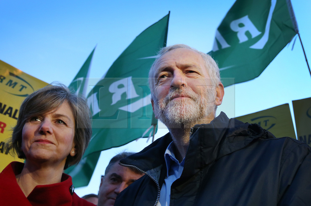 © Licensed to London News Pictures. 04/01/2016. London, UK. Labour leader Jeremy Corbyn stands with Shadow Secretary of State for Transport Lilian Greenwood and demonstrators at King's Cross station calling for lower rail fares. Photo credit: Peter Macdiarmid/LNP