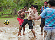 Playing water football during the monsoon season. Mangalore, Karnataka, India.