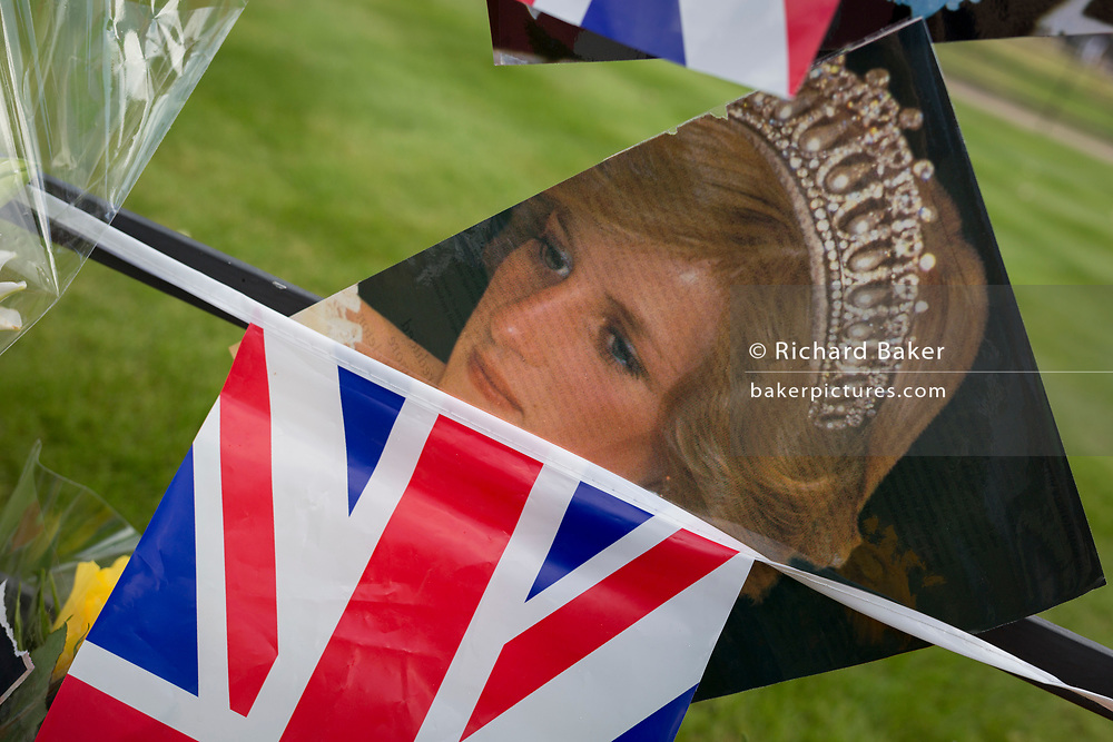 As crowds of royalist well-wishers gather, a spontaneous memorial of flowers, photos and memorabilia grows outside Kensington Palace, the royal residence of Princess Diana who died in a car crash in Paris exactly 20 years ago, on 31st August 2017, in London, England. In 1997 a sea of floral tributes also filled this area of the royal park as well as in the Mall where her funeral passed. Then, as now - a royalists mourned the People's Princess, a titled coined by the then Prime Minister Tony Blair.