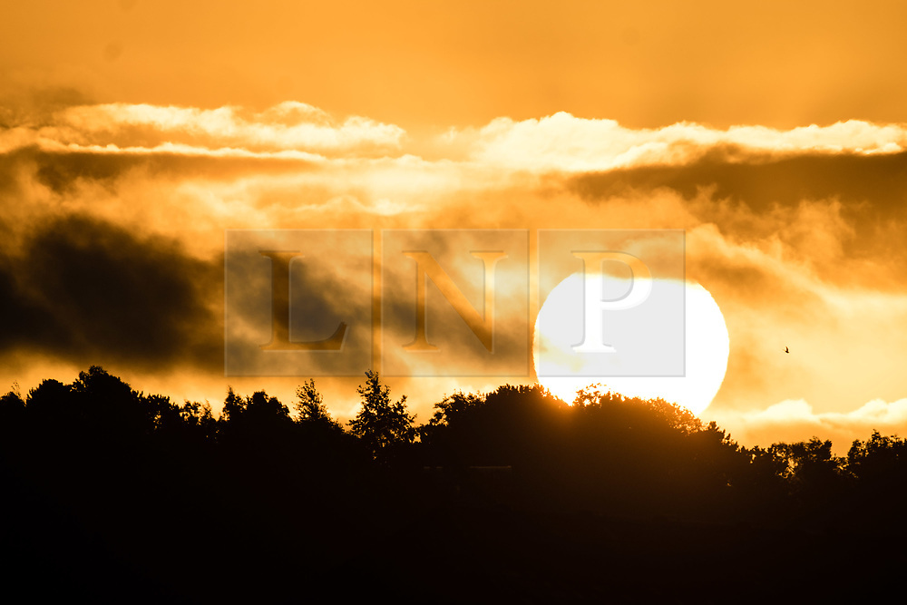 © Licensed to London News Pictures. 22/09/2017. Aberystwyth, Wales, UK. Glorious sunrise on the morning of the Autumn Equinox, when the night and day are roughly equal length, on September 22 2017,  at Aberystwyth on the coast of west Wales. According to the astronomical calendar, today marks the first day of Autumn in the northern hemisphere. Photo credit: Keith Morris/LNP