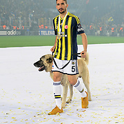 Fenerbahce players celebrate with the Turkish Super League championship trophy at the Sukru Saracoglu stadium Istanbul May 11, 2014.  Photo by TURKPIX
