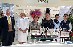 Prince Andrew, Duke of York presents the trophies to Jockey Colm O'Donoghue, trainer Jessica Harrington and owners the Niarchos Family after winning the Coronation Stakes with Alpha Centauri during day four of Royal Ascot at Ascot Racecourse.