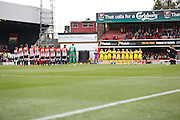 Both teams show their respects with a minutes applause  before the Sky Bet Championship match between Brentford and Rotherham United at Griffin Park, London, England on 17 October 2015. Photo by Andy Walter.