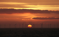 © Licensed to London News Pictures. 20/03/2014. North Wales, UK. The sun rises over the Rhyl Flats Offshore Wind Farm off North Wales this morning, 20th March 2014. Photo credit : Rob Arnold/LNP