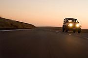 A jeep speeding along i-84 at dusk. Washington.