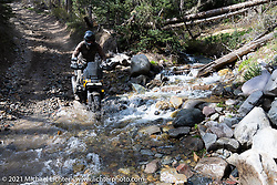 Danger Dan Hardick riding his 2-week old Harley-Davidson Pan-America adventure bike through water on a trail just outside Red River, NM, USA. Sunday, May 30, 2021. Photography ©2021 Michael Lichter.