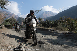 Kelly Modlin with the Annapurna Range in the background on Day-7 of our Himalayan Heroes adventure riding from Tatopani to Pokhara, Nepal. Monday, November 12, 2018. Photography ©2018 Michael Lichter.