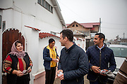 Roma activist Marius Tudor (right) is explaining the importance of political participation which is necessary to bring change. During the last door to door meeting with Roma community members of Marginenii de Jos before the final round of the presidential elections two days later in Romania. The campaigners supported Victor Ponta who lost the presidential elections in the end.