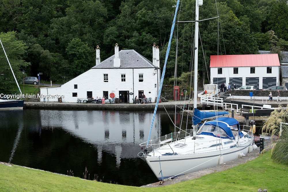 View of basin with yacht on Crinan Canal in Argyll and Bute in Scotland, United Kingdom