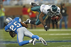 DETROIT - SEPTEMBER 19: Wide Receiver Jason Avant #81 of the Philadelphia Eagles gets a first down as he is upended by defensive back Randy Phillips #25 the Detroit Lions on September 19, 2010 at Ford Field in Detroit, Michigan. The Eagles won 35.32. (Photo by Drew Hallowell/Getty Images)