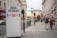 Social distancing street sign in Regent Street, London, UK