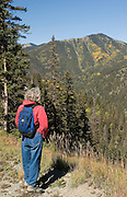 Vertical of woman hiker above Taos Ski Valley, New Mexico<br />