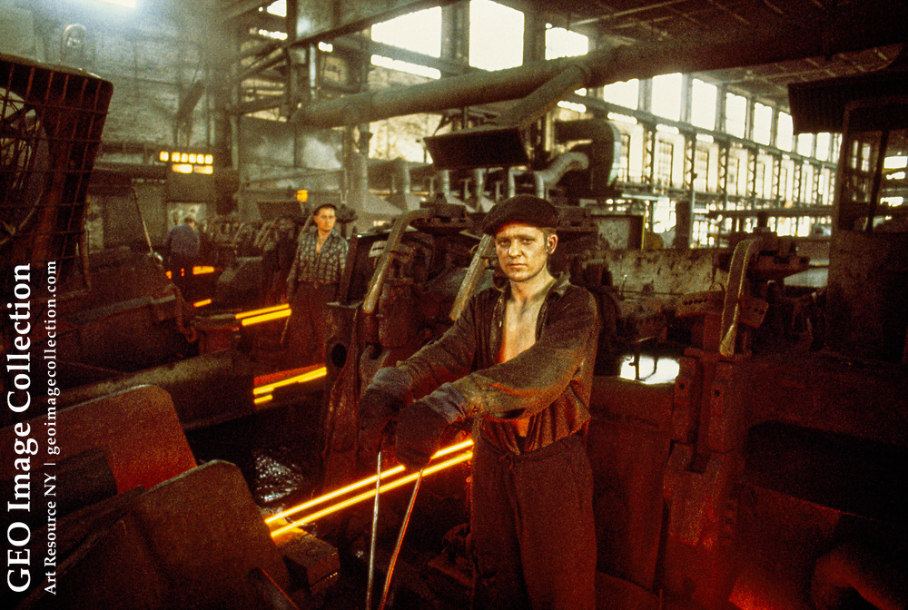 Workers at a steel wire mill.