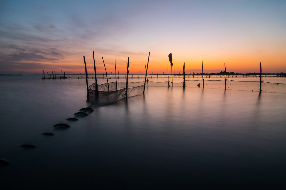A typical fishing net of the Northern Lagoon of Venice, close to Burano Island, is seen at sunrise.