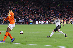March 24, 2019 - Amsterdam, France - AMSTERDAM, Football, 24-03-2019, Euro qualification, Stadium Johan Cruyffarena, Germany player Nico Schulz(r) scoring the 2-3 during the game Netherlands - Germany. (Credit Image: © Panoramic via ZUMA Press)