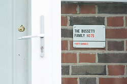 © Licensed to London News Pictures. 06/11/2018. South Norwood, UK. The home of Paul Bussetti with family sign. A father and son from South London and their neighbour have been arrested by police after hosting a Greenfell Tower effigy bonfire party its believed to have been at the home of Cliff Smith.  Photo credit: Grant Falvey/LNP