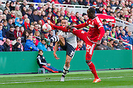 Middlesbrough FC defender Mark Kitchingwins the ball from Fulham defender Jazz Richards during the Sky Bet Championship match between Middlesbrough and Fulham at the Riverside Stadium, Middlesbrough, England on 17 October 2015. Photo by George Ledger.