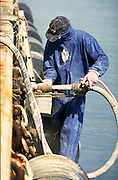 Industrial worker repairs a ship in Sydney Harbour.