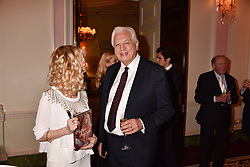 Basia Briggs and John Simpson at a reception to celebrate the publication on 'Mother Anguish' by Basia Briggs held in The Music Room, The Ritz Hotel, 150 Piccadilly, London, England. 04 December 2017.