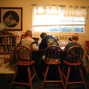 Left to right, Bryce, Trevor and Andrew work on Language Arts in the 120 sq. ft bedroom that serves as Mission Prep's only classroom. The three boys were pulled from the local elementary school and taught at home by their mother who was unhappy with the academics at the neighborhood school