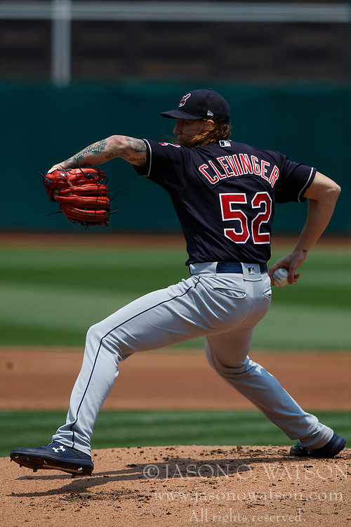 OAKLAND, CA - JULY 01:  Mike Clevinger #52 of the Cleveland Indians pitches against the Oakland Athletics during the first inning at the Oakland Coliseum on July 1, 2018 in Oakland, California. The Cleveland Indians defeated the Oakland Athletics 15-3. (Photo by Jason O. Watson/Getty Images) *** Local Caption *** Mike Clevinger