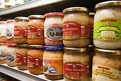 Jars of Polish food products stacked on shelf in Polish Delicatessen,