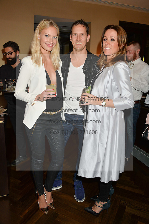 Left to right, BRENDAN & ZOE COLE and NATALIE PINKHAM at a party to celebrate the 15th anniversary of Myla held at the House of Myla, 8-9 Stratton Street, London on 21st October 2014.
