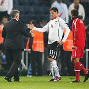 Turkey's coach Guus HIDDINK (L) and Austria's Marko ARNAUTOVIC (C) during their UEFA EURO 2012 Qualifying round Group A soccer match Turkey betwen Austria at Sukru Saracoglu stadium in Istanbul March 29, 2011. Photo by TURKPIX