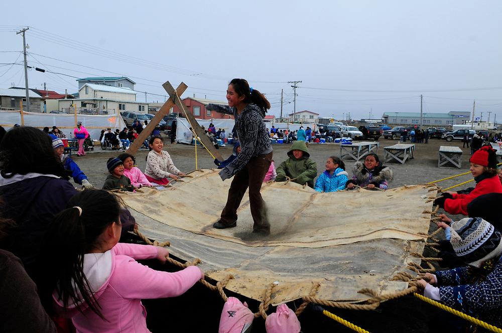 Barrow, Alaska Blanket toss traditional native celebration summer Naukataq. MR