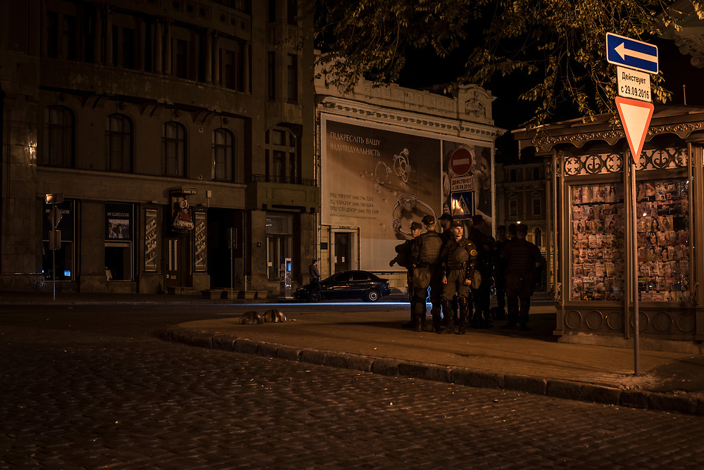 A group of police stand on a sidewalk in the center of Odessa, Ukraine.<br /> <br /> (September 2016)