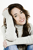 studio portrait of a expressive caucasian beautiful charming woman on white background