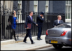The Prime Minister David Cameron leaves No10 Downing Strret just before the The Chancellor George Osborne poses on the steps of No11 Downing street with his red budget box for the 2014 Budget, London, United Kingdom. Wednesday, 19th March 2014. Picture by Andrew Parsons / i-Images