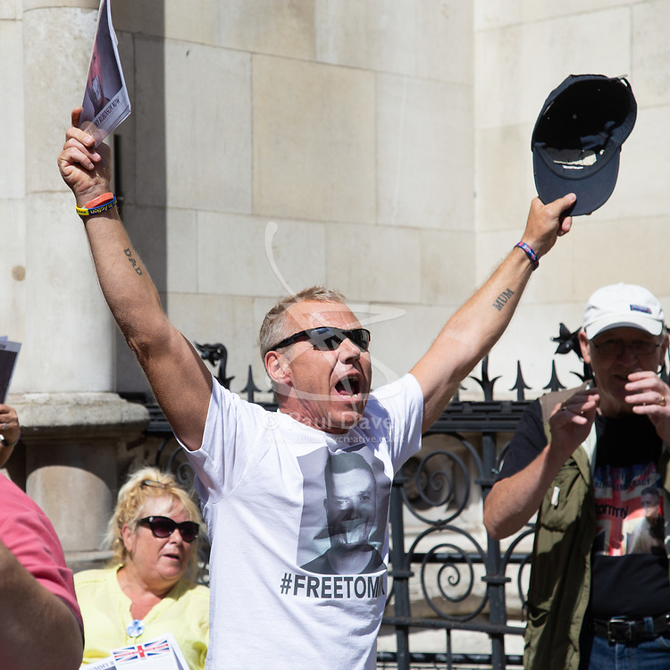 "Tommy Robinson's supporters cheer and chant ""Tommy's Coming Home"" as an appeal by lawyers representing right wing activist Tommy Robinson win his release on bail ahead of a new hearing to be held at The Old Bailey, following his imprisonment on contempt of court charges. London, August 01 2018."