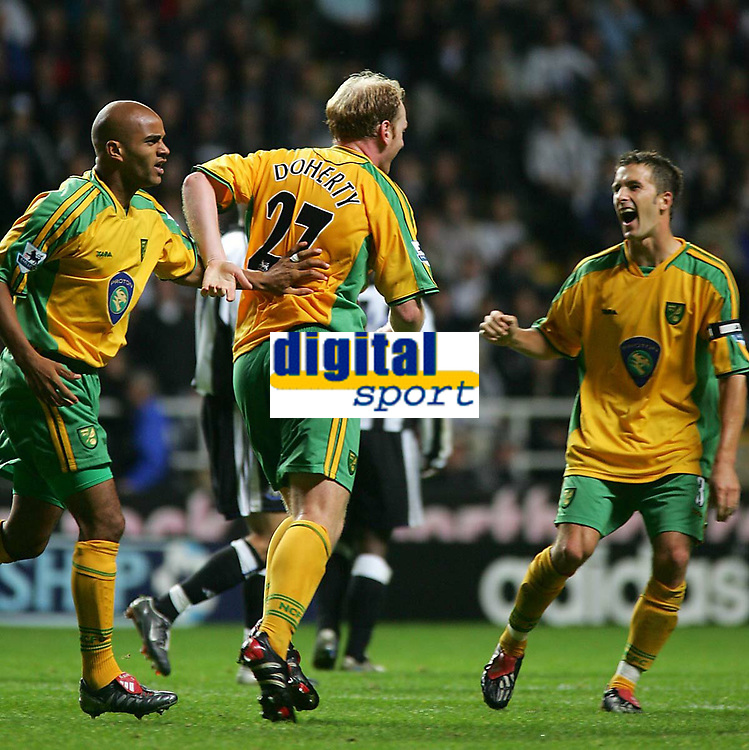 Photo. Andrew Unwin.<br /> Newcastle United v Norwich, Barclays Premiership, St James Park, Newcastle upon Tyne 25/08/2004.<br /> Norwich's Gary Doherty (C) celebrates scoring the equaliser with Leon McKenzie (L) and Adam Drury (R)