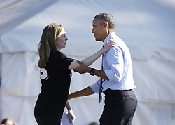 November 7, 2016 - Warren, MI, USA - Chelsea Clinton hugs President Barack Obama after she announces him as they stump for Democratic nominee, her mother, Hillary Clinton, on the eve of the election at the Ray L. Fisher Stadium Monday, Nov. 7, 2016 in Ann Arbor, Mich. (Credit Image: © Mandi Wright/TNS via ZUMA Wire)