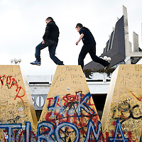 """Pristina, Kosovo 17 February 2011<br /> Youngsters play on the """"Newborn"""" monument, during the celebrations of the 3rd anniversary of Kosovo's Independence.<br /> After the Kosovo War and the 1999 NATO bombing of Yugoslavia, the territory of Kosovo came under the interim administration of the United Nations Mission in Kosovo (UNMIK), and most of those roles were assumed by the European Union Rule of Law Mission in Kosovo (EULEX) in December 2008. <br /> In February 2008 individual members of the Assembly of Kosovo declared Kosovo's independence as the Republic of Kosovo. Its independence is recognised by 75 UN member states. <br /> On 8 October 2008, upon request of Serbia, the UN General Assembly adopted a resolution asking the International Court of Justice for an advisory opinion on the issue of Kosovo's declaration of independence.<br /> On 22 July 2010, the ICJ ruled that Kosovo's declaration of independence did not violate international law, which its president said contains no """"prohibitions on declarations of independence"""".<br /> Photo: Ezequiel Scagnetti"""