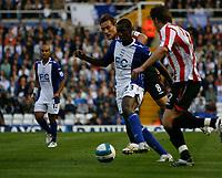Photo: Steve Bond.<br />Birmingham City v Sunderland. The FA Barclays Premiership. 15/08/2007. Olivier Kapo (C) attacks during the first half