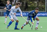 AMSTELVEEN - Marlon Landbrug (Pinoke)  met Bram van Battum (Kampong)   tijdens   hoofdklasse hockeywedstrijd mannen, Pinoke-Kampong (2-5) . COPYRIGHT KOEN SUYK