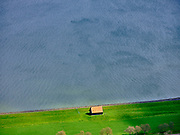 Nederland, Noord-Holland, gemeente Hollands Kroon, 07-05-2021; Wieringermeer, Wieringerwerf, Noorderdijkweg nabij het Dijkgatbos. Dijkmagazijn, Wieringermeer, Wieringerwerf, Noorderdijkweg near the Dijkgatbos. A dike warehouse.<br /> luchtfoto (toeslag op standard tarieven);<br /> aerial photo (additional fee required)<br /> copyright © 2021 foto/photo Siebe Swart