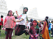 """The Festival of Colors was celebrated at the  India Cultural Center and Temple on Saturday in Memphis on March 24, 2018. Hundreds of participants playfully throw brightly colored powder on each other while shouting """"Happy Holi"""". This Festival of Colors is to welcome spring in the mid-south. Photo By © Karen Pulfer Focht-"""