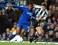 Photo: Ed Godden.<br /> Chelsea v Newcastle United. The FA Cup. 22/03/2006.<br /> Didier Drogba(L) is challenged by Robbie Elliott (Newcastle)