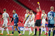 Wycombe Wanderers midfielder Curtis Thompson (18) gets a yellow card during the EFL Sky Bet League 1 Play Off Final match between Oxford United and Wycombe Wanderers at Wembley Stadium, London, England on 13 July 2020.