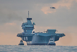 © Licensed to London News Pictures. 16/08/2017. Portsmouth, UK. The Royal Navy's new aircraft carrier HMS Queen Elizabeth heads for her home port of Portsmouth for the first time. The new ship at 65,000 tonnes is the biggest warship ever built in the UK. Photo credit: Peter Macdiarmid/LNP