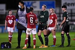 Chloe Logarzo of Bristol City Women laughs with Alanna Kennedy of Tottenham Hotspur Women as she receives treatment - Mandatory by-line: Ryan Hiscott/JMP - 14/11/2020 - FOOTBALL - Twerton Park - Bath, England - Bristol City Women v Tottenham Hotspur Women - Barclays FA Women's Super League
