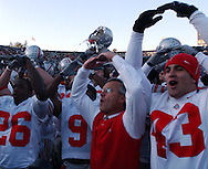 MORNING JOURNAL/DAVID RICHARD.Ohio State coach Jim Tressel and the  Buckeyes sing the Ohio State alma mater after the game.