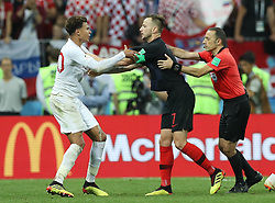 MOSCOW, July 11, 2018  Dele Alli (L) of England clashes with Ivan Rakitic (C) of Croatia during the 2018 FIFA World Cup semi-final match between England and Croatia in Moscow, Russia, July 11, 2018. Croatia won 2-1 and advanced to the final. (Credit Image: © Xu Zijian/Xinhua via ZUMA Wire)