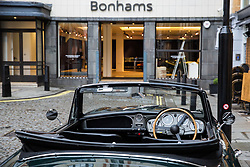 London, UK. 29th November, 2018. A 1958 Aston Martin DB MkIII Drophead Coupé stands outside auctioneers Bonhams in preparation for an auction of an array of historic and high-performance racing and road cars. Highlights include a Le Mans class-winning Jaguar XJ220C driven by David Coulthard (£2,200,000-2,800,000), a Lister Jaguar Knobbly (£2,200,000-2,800,000) and a 1958 BMW 507 owned by its designer, as well as Ferraris, Aston Martins, Bentleys, Porsches and Jaguars. Bonhams, founded in 1793, is one of the world's largest and most renowned auctioneers of fine art and antiques, motor cars and jewellery.