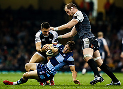 Lloyd Williams of Cardiff Blues under pressure from Owen Watkin of Ospreys with team-mate Alun Wyn Jones<br /> <br /> Photographer Simon King/Replay Images<br /> <br /> Guinness PRO14 Round 21 - Cardiff Blues v Ospreys - Saturday 27th April 2019 - Principality Stadium - Cardiff<br /> <br /> World Copyright © Replay Images . All rights reserved. info@replayimages.co.uk - http://replayimages.co.uk