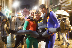 © licensed to London News Pictures. London, UK 01/01/2014. A group of revellers dressed as superheroes in Soho, London celebrating the New Year at the first hours of 2014. Photo credit: Tolga Akmen/LNP